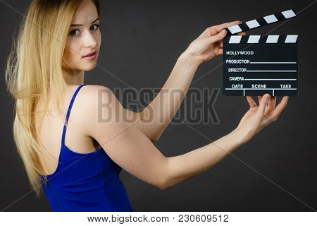 Woman Holding Professional Film Slate, Movie Clapper Board. Hollywood Production Objects Concept. St