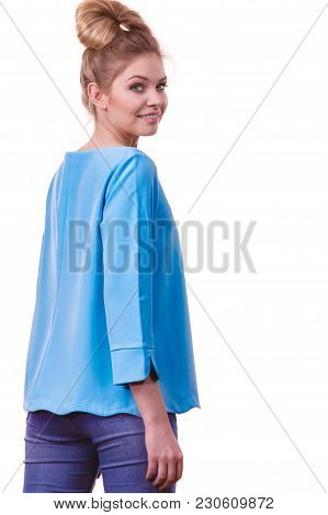 Adult Woman Presenting Her Casual Beautiful Outfit, Long Sleeved Blue Top And Jeans.
