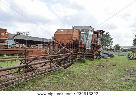 Old Rusty Disassembled Combine Harvester. Combine Harvesters Agricultural Machinery