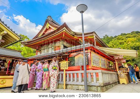 Kyoto, Japan - April 24, 2017: Worshippers Women Wearing Kimono Prays At Popular Jishu Jinja Temple