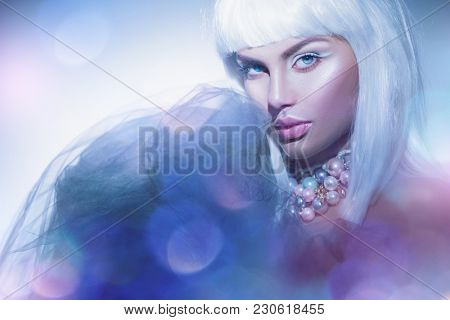 High fashion model girl portrait. Beauty woman with white hair and beautiful make-up. Winter style. Haircut. Hairstyle. Fringe. Beautiful Model with Short Blond hair. Bob. Fashion Blonde Girl