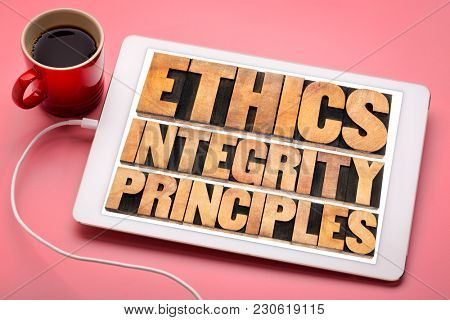 ethics, integrity and principles word abstract - ethical concept on a digital tablet with a cup of coffee