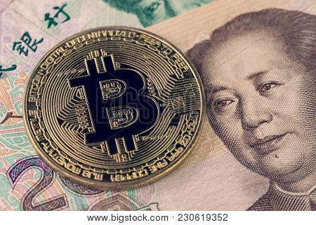 Bitcoin Crypto Currency Banned In China Concept, Closed Up Shot Of Golden Physical Coin With B Sign
