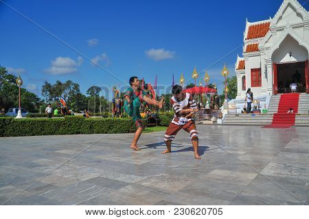 Phitsanulok, Thailand - April 8, 2011: Two Men In Traditional Dress Holidng Sword Demonstrating Thai