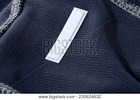 Security tag on cloth to prevent shoplifting.