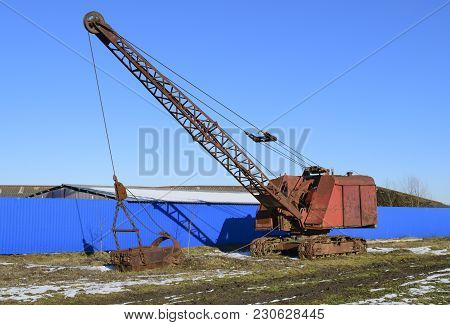 Old Quarry Near The Dragline. Old Equipment For Digging The Soil In Canals And Quarries.