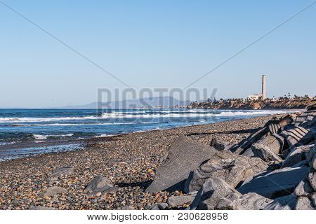 South Carlsbad State Beach In San Diego, California, With A Power Station Tower And Mountain Range I