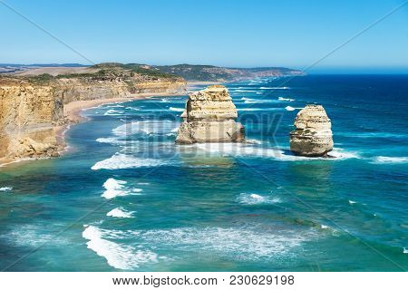 Two Of Twelve Apostels With Blue Ocean And Cloudless Sky At The Great Ocean Road, Victoria, Australi