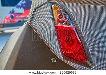 Rear Headlight Of A Modern Sports Snowmobile Close-up. Rear View.