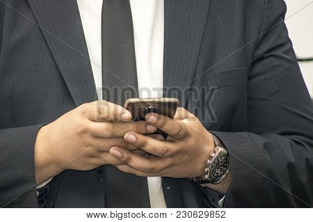 Sao Paulo, Sp, Brazil, December 13, 2017. Detail Of A Suit Executive Handling His Smartphone, Cellul
