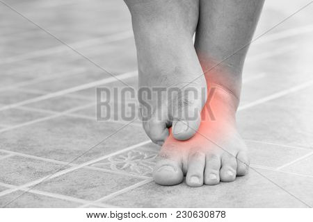 Close Up Man Scratch The Itchy Feet By Other Foot At Home. Healthcare And Medical Concept.