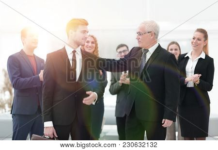 portrait of business partners on the background of business team.