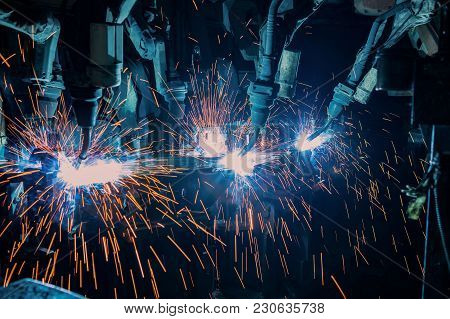 Industrial Welding Robots Are Movement Welding In Production Line