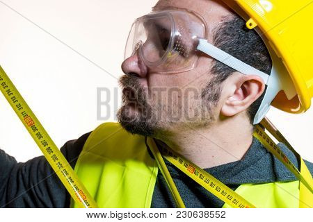 a man who wants to do a work without knowledge, work without experience. Do it yourself, man dressed in yellow builder helmet with protective glasses ready to start the construction work