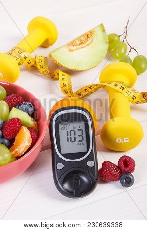 Fresh Fruit Salad, Glucose Meter With Result Of Sugar Level, Tape Measure And Dumbbells For Fitness,