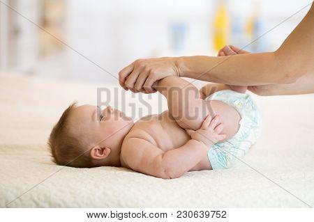Mother Or Masseur Massaging Little Baby Boy
