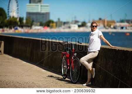 Woman and bike on pier