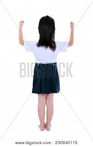 Back View. Full Body Of Preschool Child In Uniform With Her Hands Up. Asian Girl Standing At Studio,