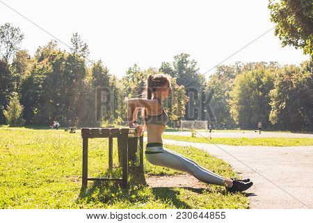Fitness, Sport, Exercising, Training And People Concept - Couple Doing Triceps Dip Exercise On City