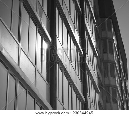 Apartment building. Multistory building. Apartment block. Monochrome. Architectural background.Housing estate. Residential neighborhood.