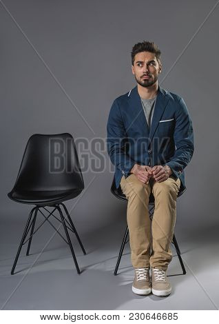 Full Length Portrait Of Nervous Male Is Open-eyed. He Is Waiting For His Turn On Chair. Copy Space I