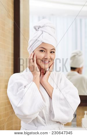 Smling Young Woman In Bathrobw With Towel On Her Head