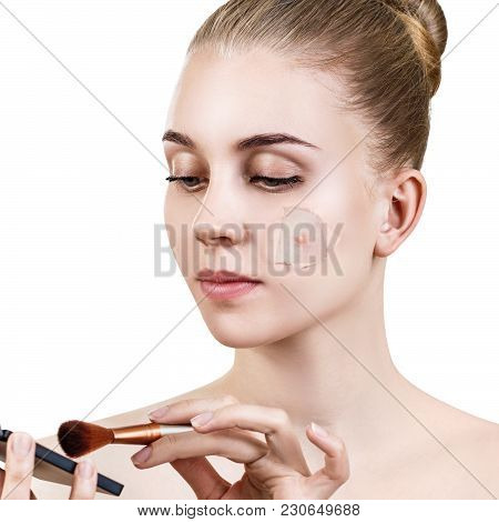 Young Woman With Pimple On Face Peek From Hole In Foundation. Isolated On White.