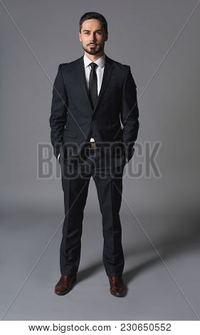 Full Length Portrait Of Noble Concentratad Man In Suit And Posing. Concept Of Leadership And Booming