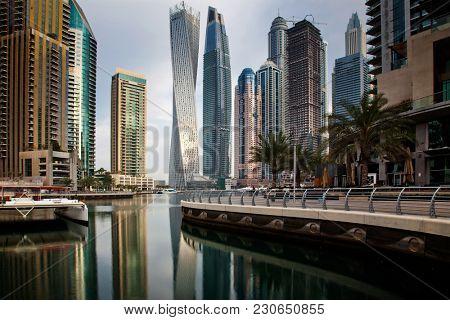 DUBAI, UAE - FEBRUARY 2018: View of modern skyscrapers shining in sunrise lights  in Dubai Marina in Dubai, UAE.