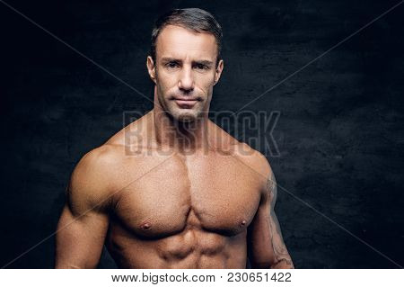 Portrait Of Muscular Shirtless Positive Middle Age Male.