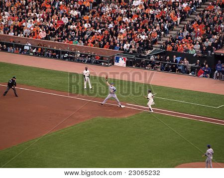 Rangers 1St Baseman Reaches Up For Ball As Giants Runner Sprints Towards 1St Base