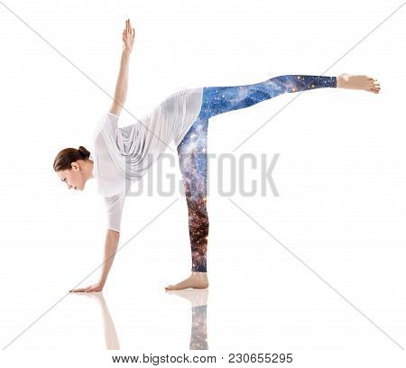 Double Exposure Of Young Flexible Woman Doing Yoga And Galaxy Space. Element Of This Image Furnished