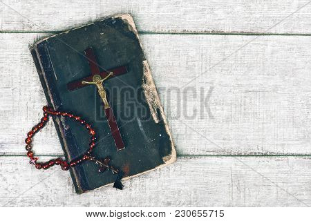 Closeup Of Wooden Christian Cross And Bible On The Old Wooden Background. Church Utensils.