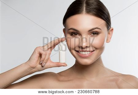 This Spray Will Cure Runny Nose. Portrait Of Cheerful Young Woman Is Holding Medical Treatment And S