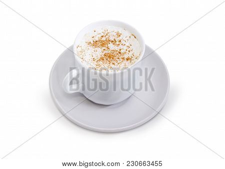 Coffee With Foamed Cream Sprinkled With Cinnamon Powder In The White Cup On The Saucer On A White Ba