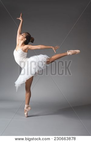 Ballet Art Concept. Full Length Of Young Woman Wearing Short Dance Skirt Standing On Tiptoes Of One