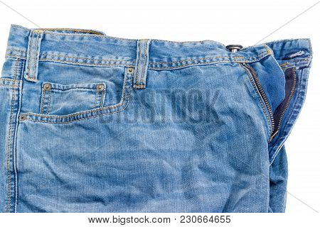 Fragment Of The Top Of The Used Crumpled Blue Jeans On A White Background