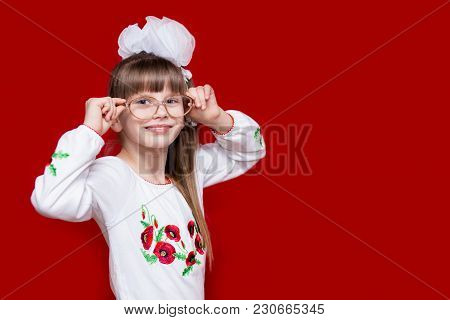 Portrait Of Cheerful Little Girl In Very Big Glasses And White Bow. Concept Of Eyesight Or Teaching.
