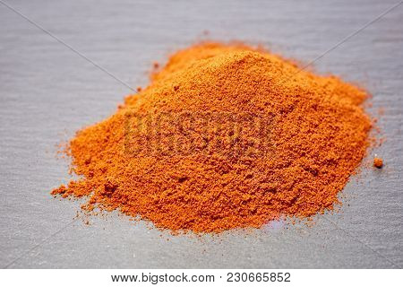 Red Ground Paprika Isolated On Light Grey Background, Shallow Depth Of Field, Top View, Close-up, Ma