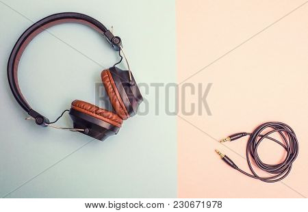 Beautiful Brown Headphones With Folded Wireon A Dual Background
