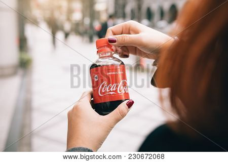 Kyoto; Japan - January 18; 2018 : Woman Hand Open A Coca Cola Bottle Caps. Coca Cola Is The Most Fam
