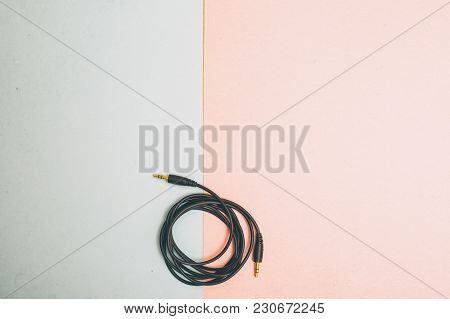 Folded Analog Musiv Cord On A Table Top Pastel Background