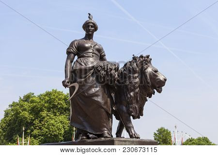 One Of Four Bronze Statues Around The Queen Victoria Memorial In Front Of The Buckingham Palace, Lon