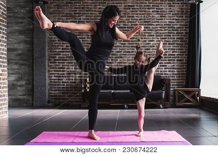 Happy Mother And Daughter Wearing Black Sportswear Having Fun While Doing Leg Stretching Exercise St