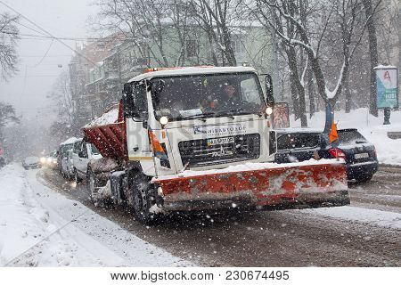 Kiev, Ukraine-march 04, 2018: Snowplow On The Road During A Snow Storm