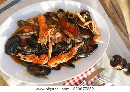 Seafood Soup In Bouille Of Tomato With Crustacean And Mussels