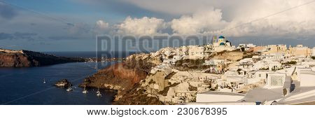 Panorama View Over The City Of Oia On The Island Of Santorini