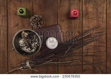 Overhead Photo Of Cauldron, Grimoire, Candles, And A Broom