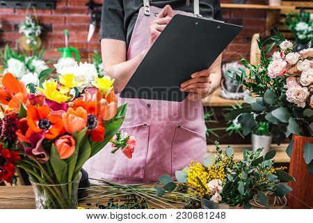 Florist Counts And Records Flowers In Florist Shop