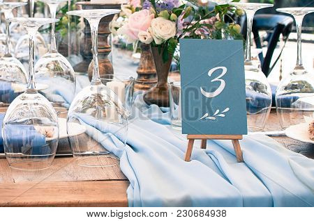 Wedding Or Another Catered Event Table Setting, Flowers, White Plates, Blue Napkins, Event Decoratio